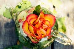 Herbal tea with rose petals and melissa. In transparent teapot, close-up Stock Photos
