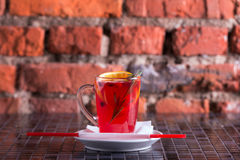 Herbal tea with rosemary and fruit Royalty Free Stock Images