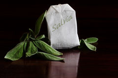Herbal tea, salvia leaves and tea bag, dark background Stock Photography