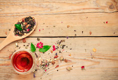 Herbal tea in a spoon and a glass Royalty Free Stock Photography