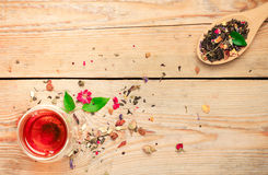 Herbal tea in a spoon and a glass Stock Images