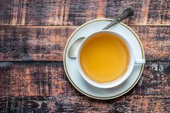 Herbal tea with spoon on wooden background Royalty Free Stock Photo
