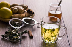 Herbal tea. Still life with tea. Natural herbal tea with mentha, honey and lemon stock photo