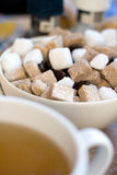 Herbal tea and sugar. A cup of herbal Tea with brown and white sugar cubes Royalty Free Stock Photography