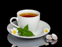 Herbal tea with sweet candys Stock Photography