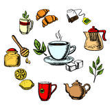 Herbal tea, sweets and dishware Royalty Free Stock Photos