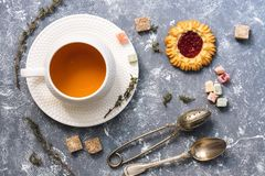 Herbal tea with sweets on a gray background, top view. Flat lay.  Stock Images