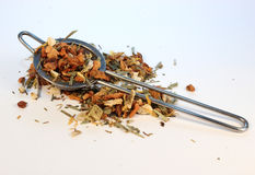 Herbal tea and tea strainer. Tea strainer holding some herbal lime tea Stock Photos
