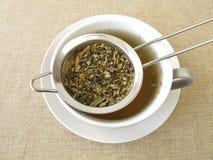 Herbal tea in tea strainer Stock Photography