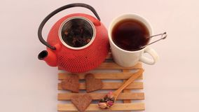 Herbal tea and teapot. Herbal tea and red teapot stock video footage