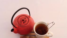 Herbal tea and teapot stock footage