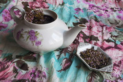 Herbal tea. Teapot and Stand, black tea with flowers and branches of heather Stock Photos