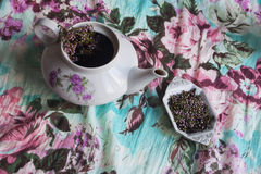 The herbal tea. Teapot and Stand, black tea with flowers and branches of heather Royalty Free Stock Image