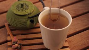 Herbal tea and traditional teapot at cafe. Herbal tea and traditional teapot pan shot stock video footage