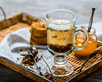 Herbal tea in a transparent mug on a tray Royalty Free Stock Photography