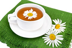 Herbal tea in a white cup with camomile Royalty Free Stock Photo