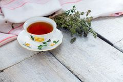 Herbal tea on a white wooden background. Royalty Free Stock Image
