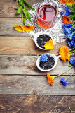 Herbal tea with wild flowers(calendula, blue cornflower) on wood Royalty Free Stock Photography
