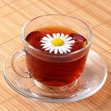 Herbal teas in cup with chamomile Royalty Free Stock Photos