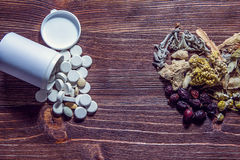 Herbal teas and drugs on wooden table. Royalty Free Stock Photo