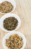 Herbal Teas In Small White Bowls On Natual Matting Stock Images