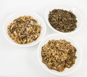 Herbal teas in small white bowls Stock Photos