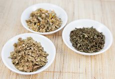 Herbal teas in small white bowls on natual matting Royalty Free Stock Image