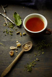 Herbal tisane infusion. On rustic table background Stock Photos