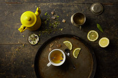 Herbal tisane infusion. On rustic table background Royalty Free Stock Images