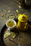 Herbal tisane infusion. On rustic table background Royalty Free Stock Image