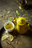 Herbal tisane infusion. On rustic table background Royalty Free Stock Photos