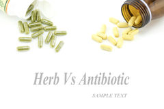 Herbal vs Antibiotic ,pills  tablets isolated. On a white background Royalty Free Stock Photography