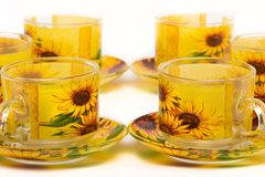 Herbata spodeczka i filiżanki ustaleni słoneczniki Obrazy Royalty Free