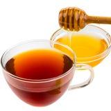 Herbata z miodem odizolowywającym na bielu Obrazy Stock