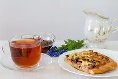 Herbata z pizzą Zdjęcie Stock