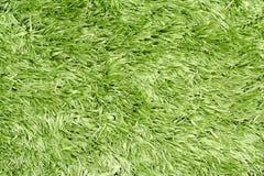 Herbe en plastique verte artificielle Images libres de droits