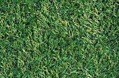 Herbe verte artificielle de terrain de football Photos stock