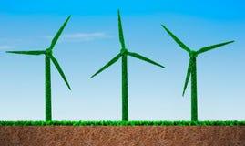 Herbe verte dans la forme de turbines de vent images libres de droits