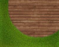 Herbe verte de ressort au-dessus du fond en bois Images stock