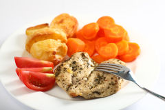 Herbed baked chicken breast meal Stock Photo