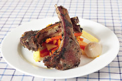 Herbed lamb chops and vegetables Stock Photo