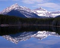 Herbert Lake, Alberta, Canada. View across Herbert lake with snow capped mountains to the rear, Alberta, Canada Stock Image