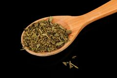 Herbes de Provence (Mixture of Dried Herbs) in Wooden Spoon on Black Background Stock Images