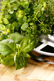 Herbs. Fresh herbs on kitchen table royalty free stock photos