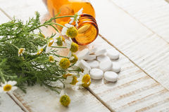 Herbs and bottle with medicines. Concept homeopathy. Stock Images