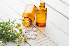 Herbs and bottle with medicines. Concept homeopathy. Royalty Free Stock Photo