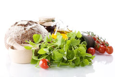Herbs, bread, vegetables and olive oil Royalty Free Stock Image