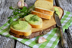 Herbs butter with bread. Stock Photography