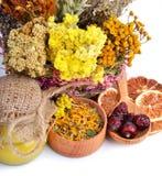 Herbs, calendula flower, honey, wild rose, dried lemon Stock Photo