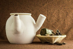 Herbs and chinese clay pot Stock Photo